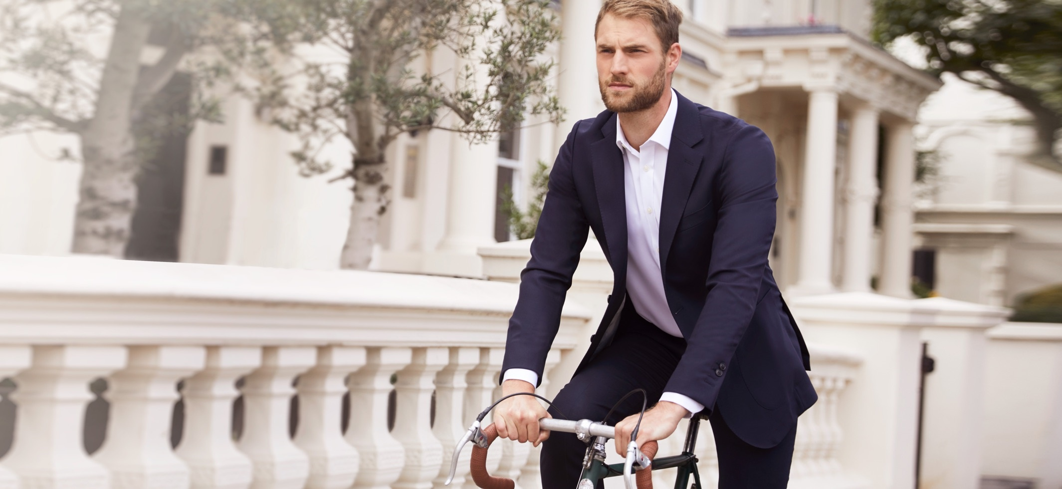 Men Bike in a Suits | Hawes & Curtis